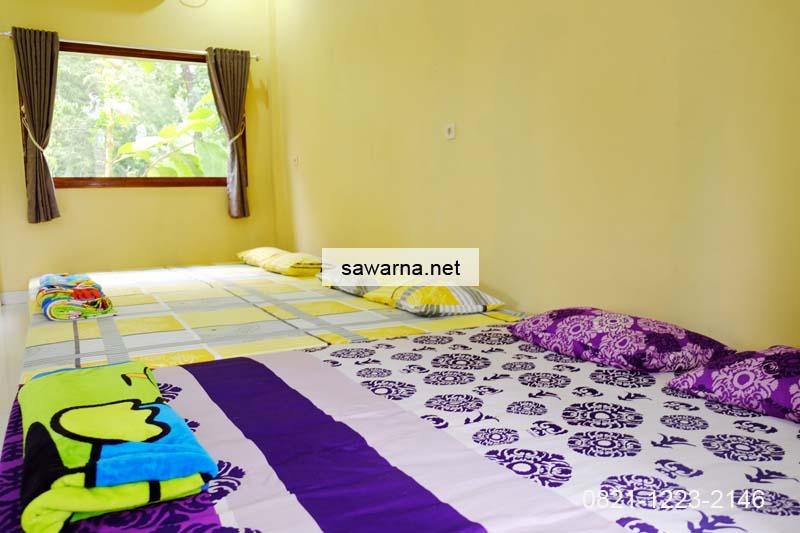 Tempat tidur homestay Andrew Sawarna